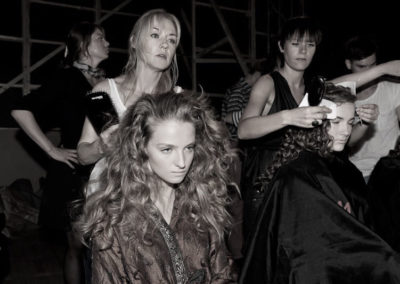 Nicci Welsh working backstage at fashion show with model